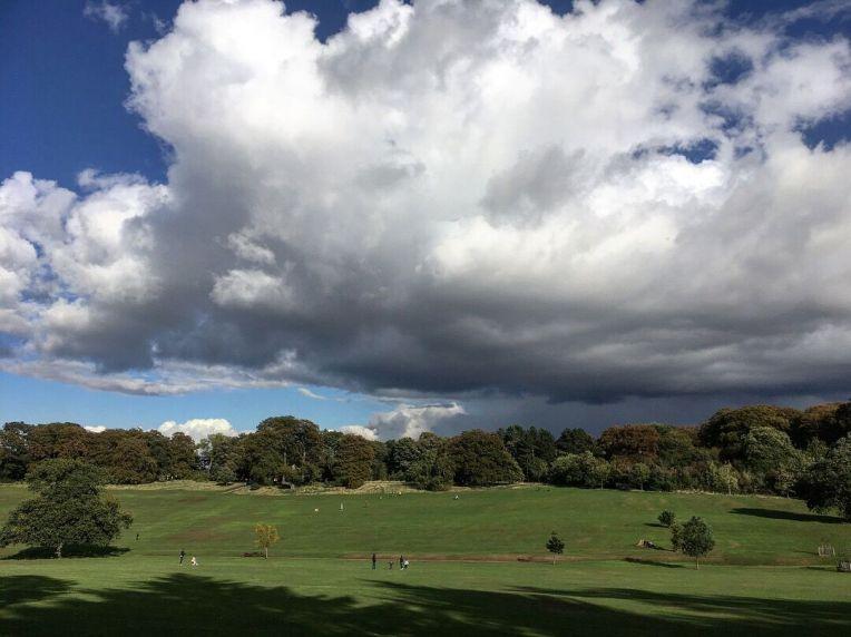 Cloudscape across the designed landscape at Warley Woods Park.