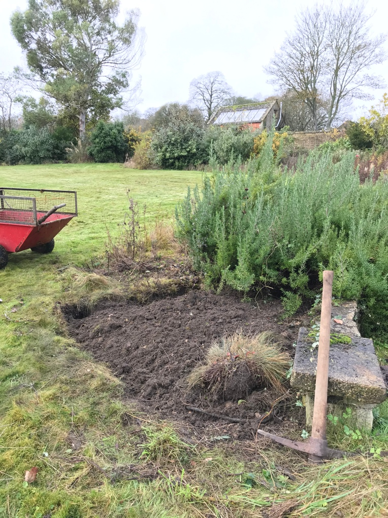 Forking over and weeding - A flower border under renovation.