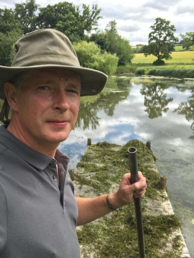 Gardening often includes pond maintenance, here in a Cotswolds garden