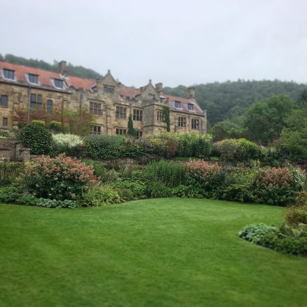 Mount Grace Manor House & Garden photograph with misty back drop and foreground of flower borders  and green lawn
